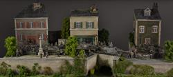 French / Belgian city and river, diorama, 127x65x62cm (vehicles, boats, sandbags and figures not included).