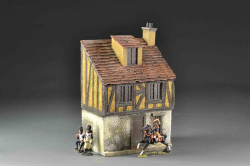 Yellow medieval house on 3 floors